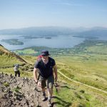 Climbing on firm paths with Loch Lomond in the background.