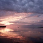 Sailing-Hebrides_Sunset-from-Muck-towards-Eigg-and-Rum