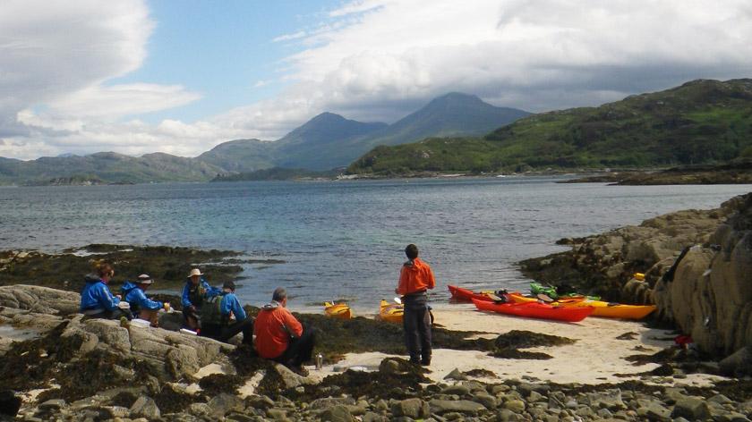 Sea kayaking beach picnic