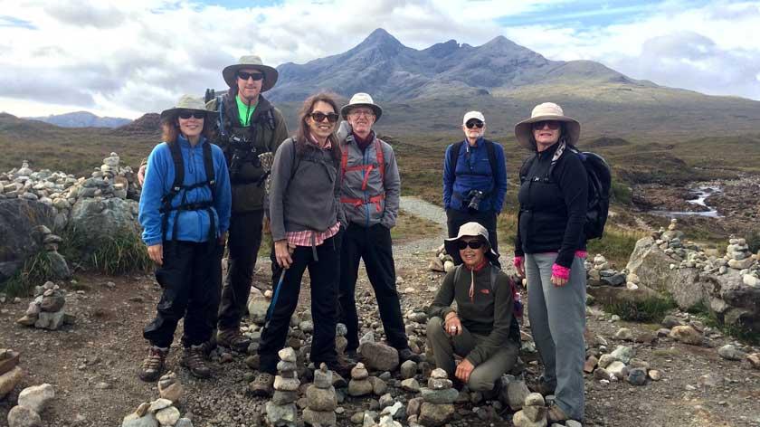Hill walkers preparing to hike in Scotland