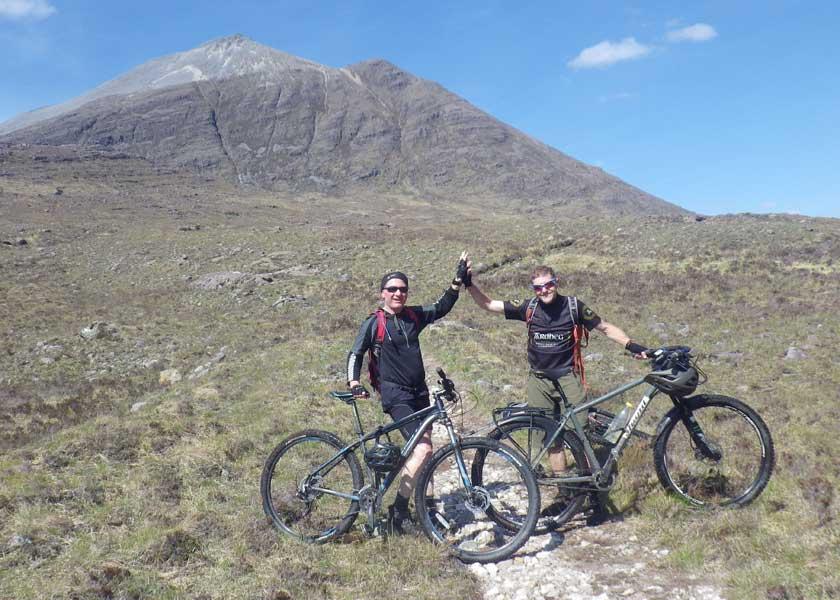 Mountain bikers celebrating after some mountain biking in the Torridon mountains in Scotland