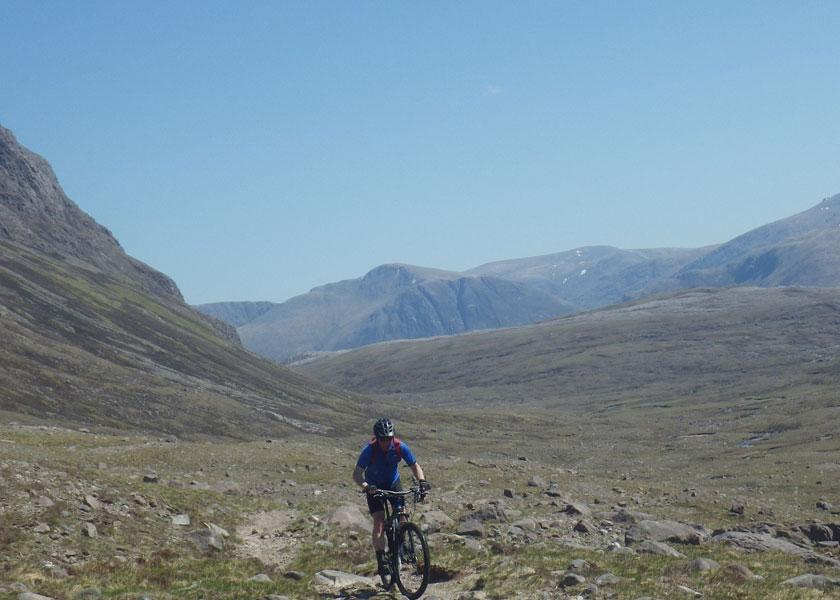 Mountain biking in the open landscape between the Torridon mountains