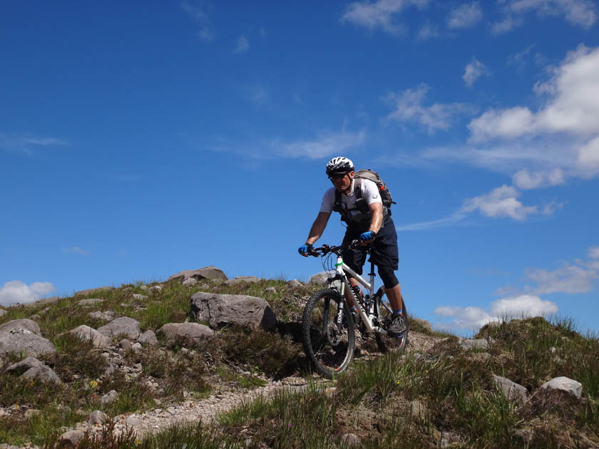 Gliding downhill by bike in the torridon landscape